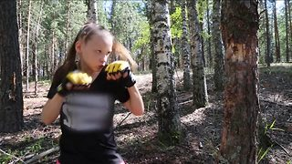 Incredible little girl smashes through tree with amazing boxing skills - Video