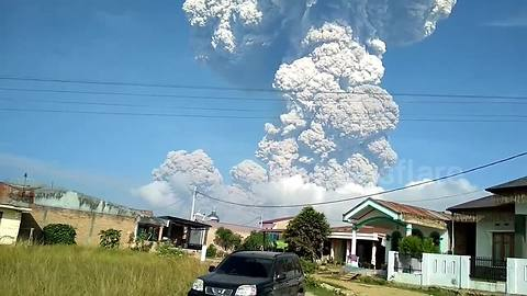 Indonesian volcano sends out plume of ash 5,000m into sky