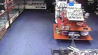 VIDEO: Man crashes car through store, tries to steal cell phones