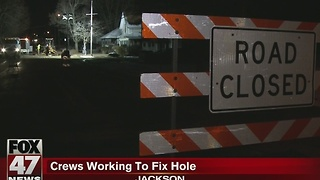 Crews working to fix hole in Jackson