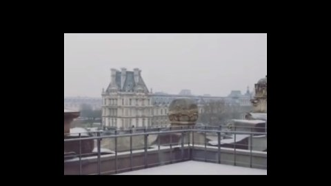 Snow Falls at Louvre in Paris as Cold Front Crosses France