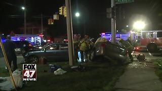 Crash closed down lanes of busy Lansing intersection Monday - Video