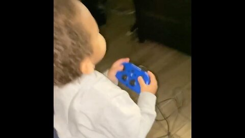 Happy kid thinks he's playing video games with his dad
