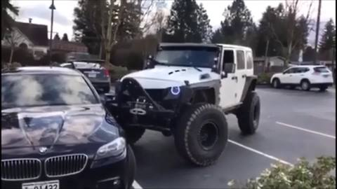 Jeep Gives Poorly Parked BMW Push In The Right Direction