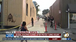 Cleanup begins after protest turns violent, several buildings burn
