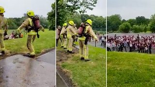 Flossing firefighters dance for children after evacuating school