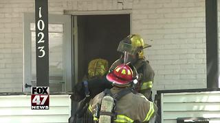 Firefighters save residents, two dogs from fire in Lansing - Video