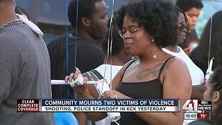 Community mourns death 2 people killed at KCK deli at vigil