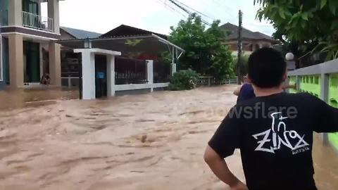 River busts banks in Thailand after downpour