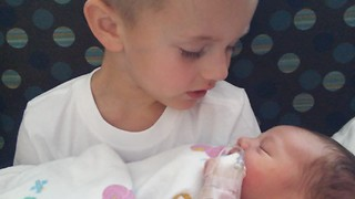 Little boy meets newborn baby brother - Video
