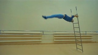 Acrobat Takes Balancing Act to a New Level - Video