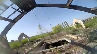 Drone Nimbly Zips Through Abandoned Building - Video