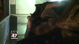 Jeep destroyed after catching fire inside parking garage - Video