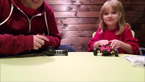Little girl helps dad review remote control car