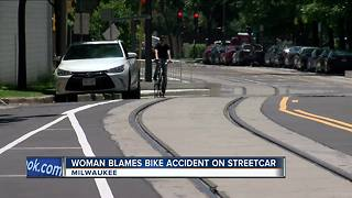 Woman blames bike accident on streetcar