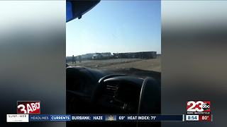 Semi truck crash blocks southbound 99 lanes near McFarland - Video