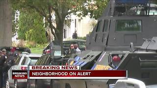 SWAT, police outside home where Cleveland officer who broke GPS monitor is believed to be hiding - Video