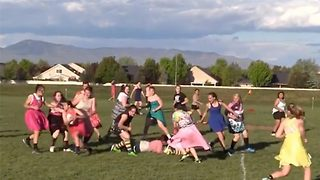 Who said rugby isn't girly? Women dressed in pretty prom dresses get stuck into the action - Video