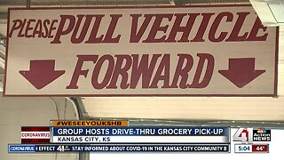 Group hosts drive-thru grocery pick-up