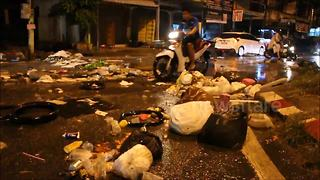 Rubbish strewn streets after heavy rain and flooding in Thailand - Video