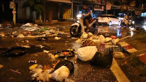 Rubbish strewn streets after heavy rain and flooding in Thailand
