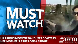 Hilarious moment daughter scatters her mother's ashes off a bridge - Video