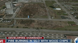 Fire burning in silo with wood chips - Video