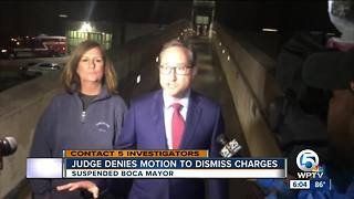 Judge won't dismiss suspended mayor's charges