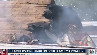 Teachers on strike rescue family from fire - Video