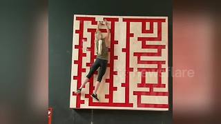 Woman takes on maze trainer in intense upper-body workout - Video