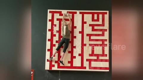 Woman takes on maze trainer in intense upper-body workout