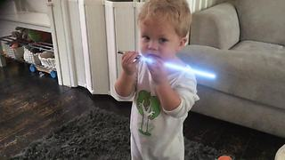 Little boy displays lightsaber skills like true Jedi