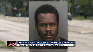 Driver attacked by homeless man at Tampa stoplight - Video