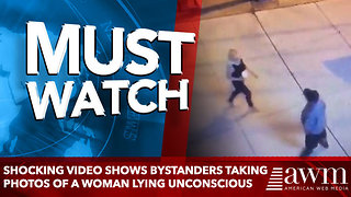 Shocking video shows bystanders taking PHOTOS of a woman lying unconscious - Video