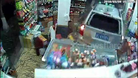 Shocking moment when a car smashes through store