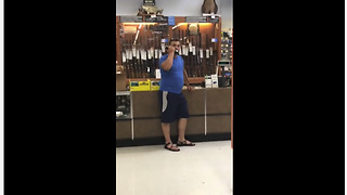 Man at store uses intercom to call for customer service - Video