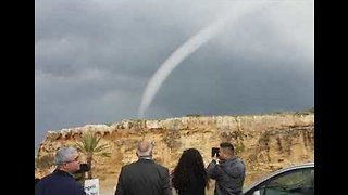Onlookers Marvel As Waterspout Forms Off Coast of Cyprus