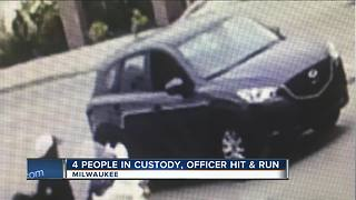4 in custody in hit-and-run crash that injured Milwaukee police officer - Video