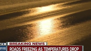 Roads freezing as temperatures drop - Video