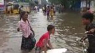 Children Play on Flooded Street as Heavy Rain Prompts School Closures in India - Video