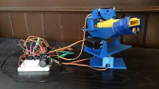 Guy invents robot that launches bottle tops into air