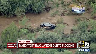 Mandatory evacuations underway in Mayer - Video