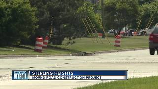 Asphalt overlay being used to fix Mound Road - Video
