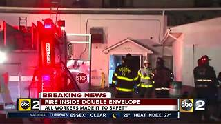 Crews at the scene of business fire in Baltimore - Video