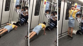 Bizarre moment woman begins doing burpees on subway carriage - Video