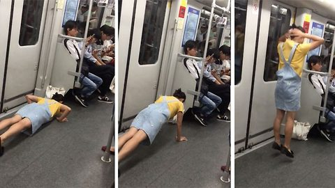 Bizarre moment woman begins doing burpees on subway carriage