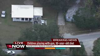 10-year-old shot after kids were home alone playing with gun - Video
