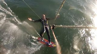 Shocked kiteboarder hits humpback whale