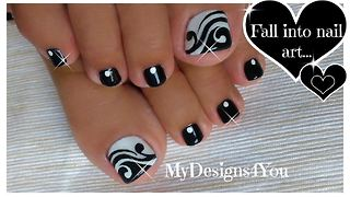 Hand painted black and white toenail art design