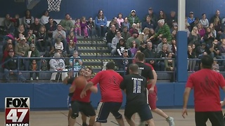 Meridian Twp. police host charity basketball game versus fire department - Video